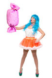 Sexy girl doll with blue hair. huge candy in the Stock Image