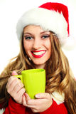 Sexy girl dressed as Santa. Portrait of a sexy girl dressed as Santa drinking coffee Stock Images