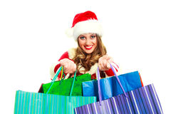 Sexy girl dressed as Santa. Portrait of a sexy young woman dressed as Santa with many shopping bags Royalty Free Stock Images