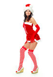 Sexy girl dressed as Santa. Beautiful young brunette woman dressed as Santa against white background Stock Images