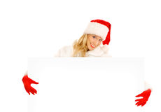 Sexy Girl dressed as Santa Claus Points Finger to Copy Spaces Stock Images