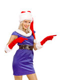Sexy Girl dressed as Santa Claus Points Finger to Copy Spaces Royalty Free Stock Photos