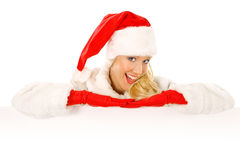 Sexy Girl dressed as Santa Claus Points Finger to Copy Spaces Royalty Free Stock Photography