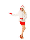 Sexy Girl dressed as Santa Claus Points Finger to Copy Spaces Royalty Free Stock Images