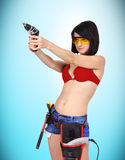 Sexy girl with drill Stock Photo