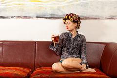 girl drinking a drink on the couch royalty free stock images