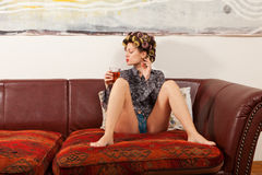 girl drinking a drink on the couch royalty free stock image