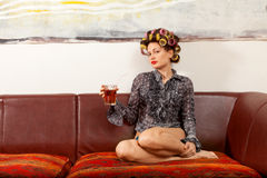girl drinking a drink on the couch stock image