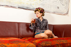 girl drinking a drink on the couch royalty free stock photography