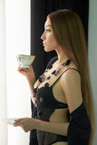 Sexy girl drinking a tea Stock Image