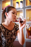 Sexy girl drinking wine Stock Images