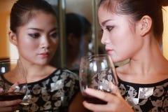Sexy girl drinking wine Royalty Free Stock Photos
