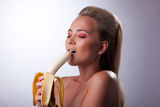 Sexy girl eat long banana with desire Stock Photo