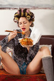 Sexy girl eating spaghetti on the couch Royalty Free Stock Photo