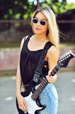 Sexy girl with electric guitar Royalty Free Stock Photos