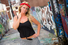 Sexy Girl with flower headband and graffiti Stock Image