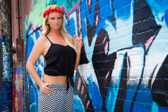 Sexy Girl with flower headband and graffiti Stock Images