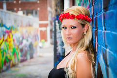 Sexy Girl with flower headband and graffiti Stock Photos