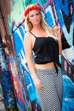 Sexy Girl with flower headband and graffiti Royalty Free Stock Image