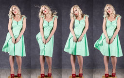 Sexy girl with flying hair posing in green dress and red shoes. different emotion in one shot.  Royalty Free Stock Image