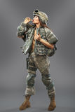Sexy girl in the form of a soldier of the American division. Stock Photos