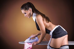 Sexy girl French Maid costume ironing panties Stock Photography