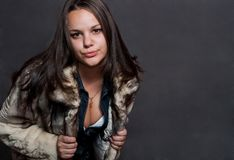 Sexy girl in fur coat Royalty Free Stock Image