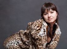 Sexy girl in fur coat Stock Photography