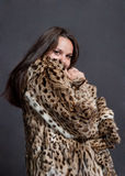 Sexy girl in fur coat Stock Photo