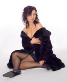 Sexy girl in a fur coat Royalty Free Stock Photo