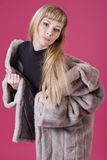 Sexy girl in a fur coat Royalty Free Stock Photos
