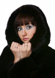 The girl in a fur coat Royalty Free Stock Photos