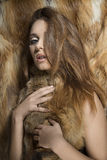 Sexy girl with fur in glamour shoot Royalty Free Stock Photo