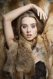 Sexy girl with fur glamour style Stock Photos