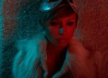 Sexy girl in fur jacket wearing mask Royalty Free Stock Image