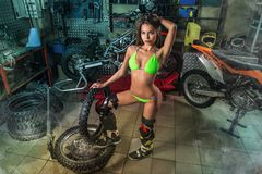 girl in garage with bike tires stock image