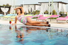 girl getting tanned on pool side Royalty Free Stock Photos