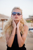girl with glasses on a beach Royalty Free Stock Image