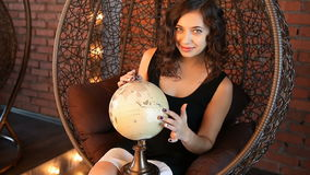 girl with a globe in the armchair stock footage