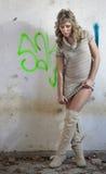 Sexy girl with graffiti Stock Photos