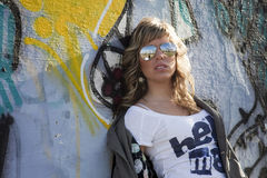 Sexy girl in graffiti wall Stock Photos