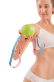 Sexy girl with green apple and measuring tape. Royalty Free Stock Images