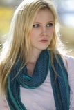 girl with green scarf stock photography