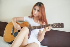 Sexy girl with a guitar Stock Image