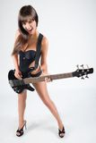 Sexy  girl with a guitar. In a black swimsuit, Stock Photo