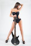 girl with a guitar. In a black swimsuit, Royalty Free Stock Image