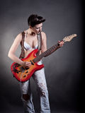 Sexy girl with a guitar playing rock Royalty Free Stock Photo