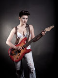 girl with a guitar playing rock Royalty Free Stock Image