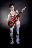 girl with a guitar playing rock Stock Photography