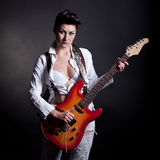 Sexy girl with a guitar playing rock Royalty Free Stock Images